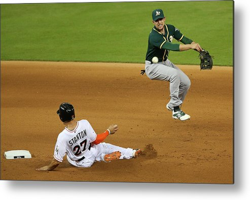 Double Play Metal Print featuring the photograph Jed Lowrie and Giancarlo Stanton by Mike Ehrmann