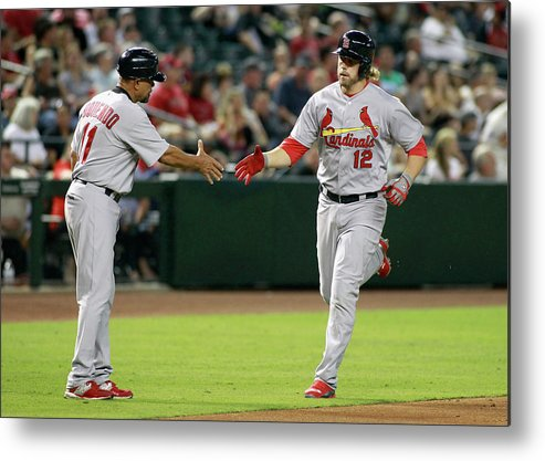 St. Louis Cardinals Metal Print featuring the photograph Jose Oquendo and Mark Reynolds by Ralph Freso