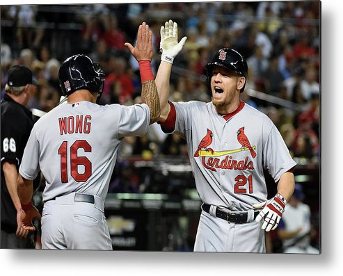 St. Louis Cardinals Metal Print featuring the photograph Kolten Wong and Brandon Moss by Norm Hall