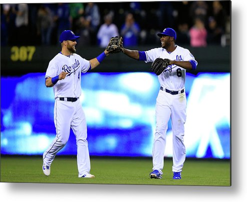 American League Baseball Metal Print featuring the photograph Lorenzo Cain and Alex Gordon by Jamie Squire