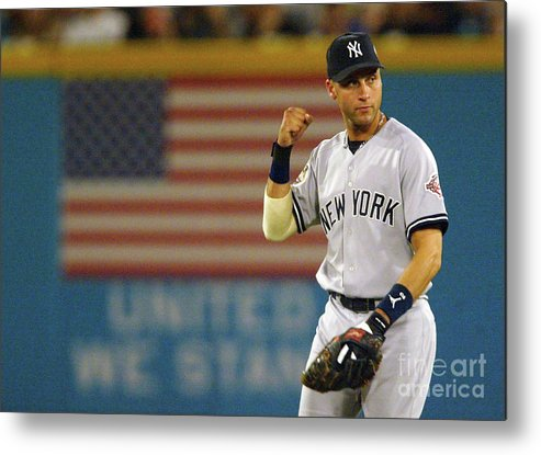 Fist Metal Print featuring the photograph Luis Castillo and Derek Jeter by Jed Jacobsohn