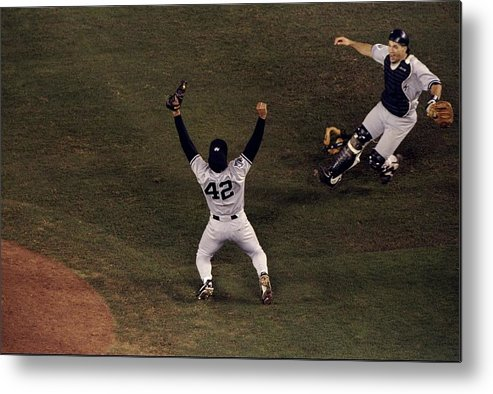 Following Metal Print featuring the photograph Mariano Rivera and Joe Girardi by Todd Warshaw