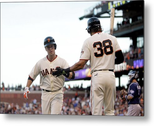 San Francisco Metal Print featuring the photograph Mike Morse and Buster Posey by Ezra Shaw