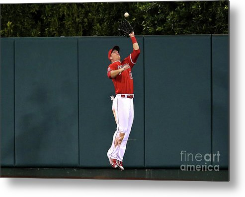 People Metal Print featuring the photograph Mike Trout and Eduardo Escobar by Stephen Dunn