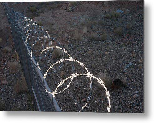 Geology Metal Print featuring the photograph Razor wire on a fence on the coast by Fotosearch