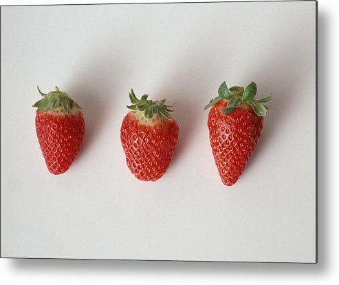 White Background Metal Print featuring the photograph Three strawberries in a row, close-up, white background by Isabelle Rozenbaum & Frederic Cirou