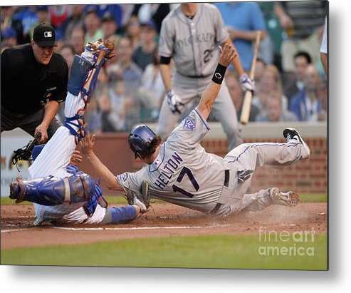Second Inning Metal Print featuring the photograph Todd Helton, Josh Rutledge, and Welington Castillo by Brian Kersey