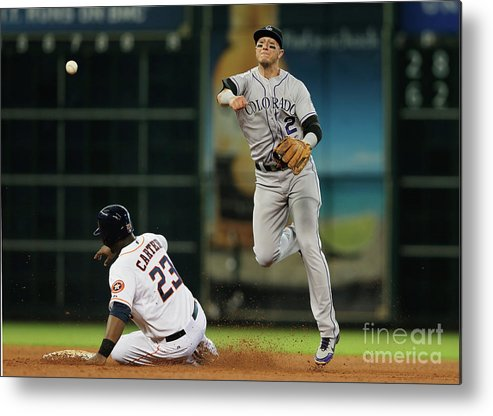 American League Baseball Metal Print featuring the photograph Troy Tulowitzki and Chris Carter by Scott Halleran