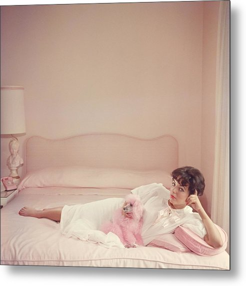 Joan Collins Relaxes Metal Print