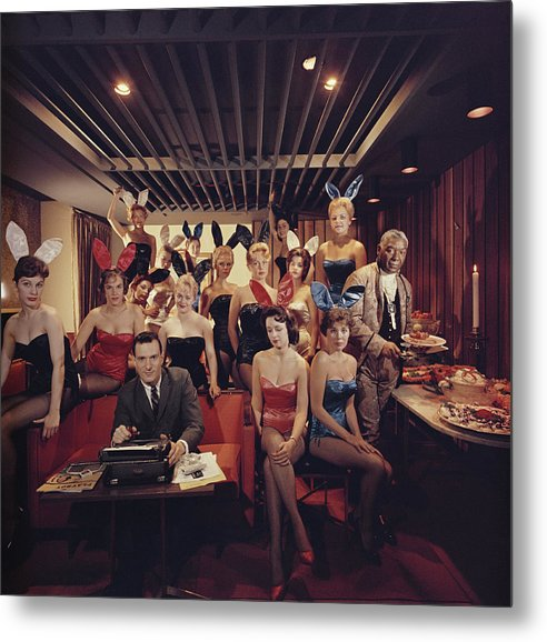 Hugh Hefner Metal Print featuring the photograph Mans Work by Slim Aarons