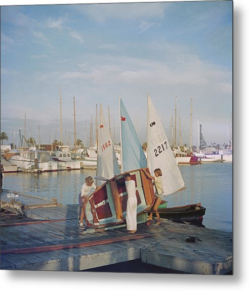 Child Metal Print featuring the photograph Sailing Dinghy by Slim Aarons