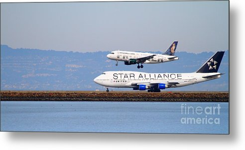 Long Metal Print featuring the photograph Star Alliance Airlines And Frontier Airlines Jet Airplanes At San Francisco Airport . Long Cut by Wingsdomain Art and Photography