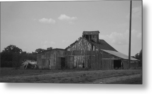 Black And White Metal Print featuring the photograph Losing The Battle With Time by Bryan Wulf