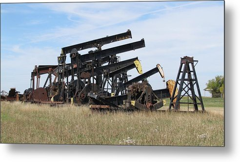 Kansas Metal Print featuring the photograph Oil Rigs by Keith Stokes