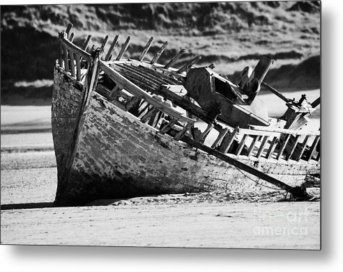 County Metal Print featuring the photograph boat wreck on bunbeg beach in gweedore gaeltacht county Donegal Republic of Ireland by Joe Fox