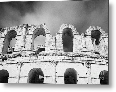 Tunisia Metal Print featuring the photograph Close Up Of The Top Of The Old Roman Colloseum Against Blue Cloudy Sky El Jem Tunisia by Joe Fox