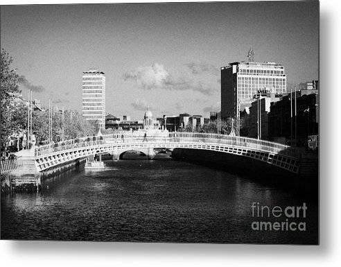 Dublin Metal Print featuring the photograph Looking Down The Liffey Towards The Hapenny Ha Penny Bridge Over The River Liffey In Dublin by Joe Fox