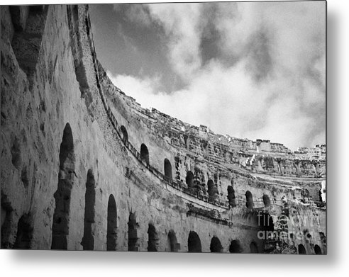 Tunisia Metal Print featuring the photograph Looking Up At Blue Cloudy Sky And Upper Tiers Of The Old Roman Colloseum At El Jem Tunisia by Joe Fox