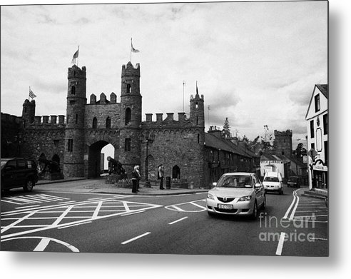 Ireland Metal Print featuring the photograph modern traffic driving past Entrance to Macroom Castle County Cork Ireland by Joe Fox