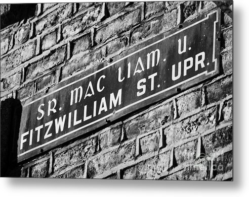 Dublin Metal Print featuring the photograph Old Style Green And White Fitzwilliam Street Upper Sign In Irish And English In Dublin On Red Brick Wall by Joe Fox