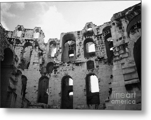 Tunisia Metal Print featuring the photograph Remains Of Tiered Arches Of The Old Roman Colloseum At El Jem Tunisia by Joe Fox