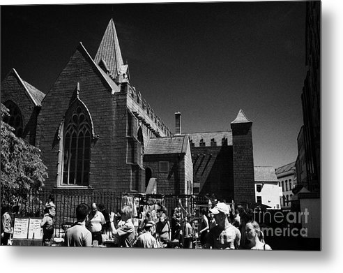 Galway Metal Print featuring the photograph shoppers in market outside St Nicholas collegiate church Galway city county Galway Republic of Irela by Joe Fox