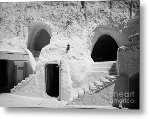 Tunisia Metal Print featuring the photograph steps from the courtyard up to the entrance of the caves at the Sidi Driss Hotel underground at Matmata Tunisia scene of Star Wars films by Joe Fox