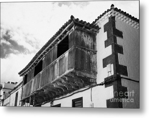 Europe Metal Print featuring the photograph wooden balcony on ancient stucco covered traditional flat roofed house in tacoronte Tenerife Canary Islands Spain by Joe Fox