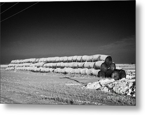 Stack Metal Print featuring the photograph stack of frozen snow covered hay bales in a field Forget Saskatchewan Canada by Joe Fox