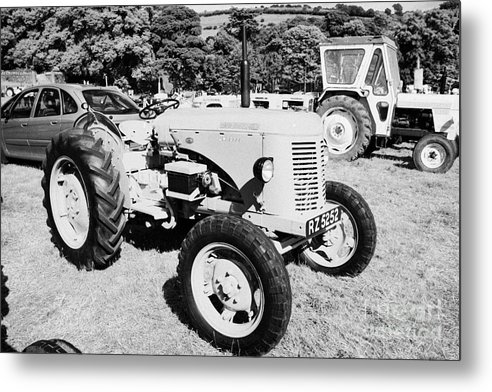County Metal Print featuring the photograph david brown 25D classic tractor during vintage tractor rally at glenarm castle open day county antrim northern ireland by Joe Fox