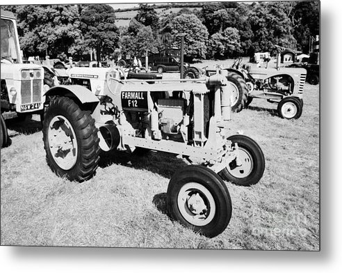 County Metal Print featuring the photograph Mccormick Deering Farmall F12 Classic Tractor During Vintage Tractor Rally At Glenarm Castle Open Day County Antrim Northern Ireland by Joe Fox