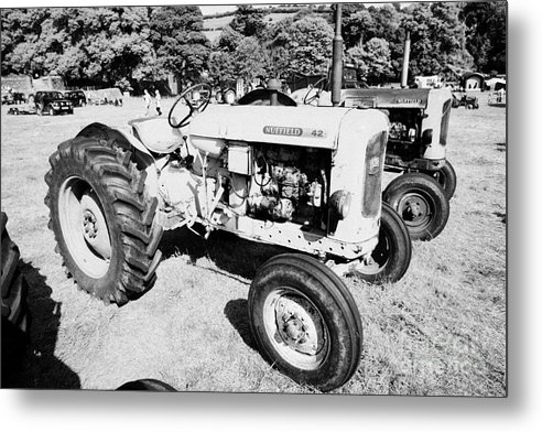 County Metal Print featuring the photograph Nuffield 342 Classic Tractor During Vintage Tractor Rally At Glenarm Castle Open Day County Antrim Northern Ireland by Joe Fox