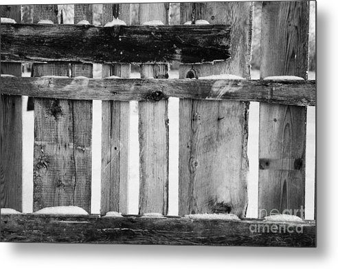 Old Metal Print featuring the photograph old patched up wooden fence using old bits of wood in snow Forget by Joe Fox