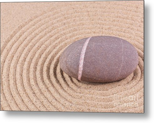 Zen Metal Print featuring the photograph Pebble In A Raked Sand Circle by Richard Thomas