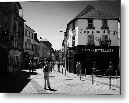 Galway Metal Print featuring the photograph people walking down pedestrian area william street on a sunday Galway city county Galway Republic of by Joe Fox