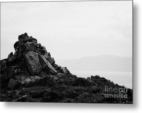 Ireland Metal Print featuring the photograph Traditional Irish Stone Cairn Basalt Stones On Rathlin Island Looking Towards Fair Head Antrim by Joe Fox