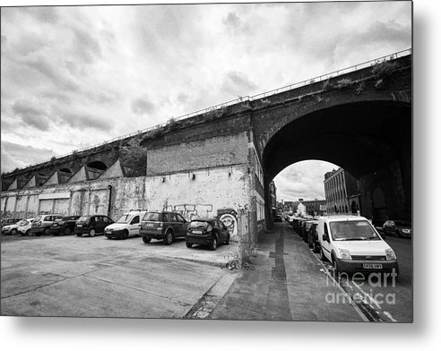 Rail Metal Print featuring the photograph railway viaduct in oxford street former industrial area of digbeth now a conservation area Birmingha by Joe Fox