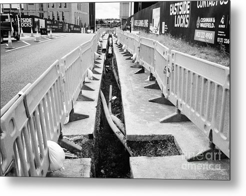 New Metal Print featuring the photograph new services trench dug to lay gas and fibre optic infrastructure Birmingham UK by Joe Fox
