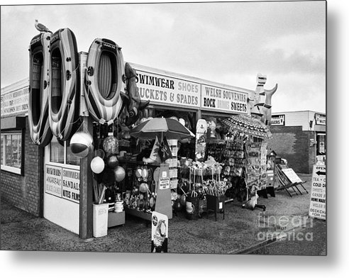 Seaside Metal Print featuring the photograph Seaside Souvenir Gift Shop On A Cold Rainy Overcast British Summer North Wales Uk by Joe Fox