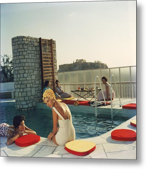 Looking Over Shoulder Metal Print featuring the photograph Penthouse Pool by Slim Aarons