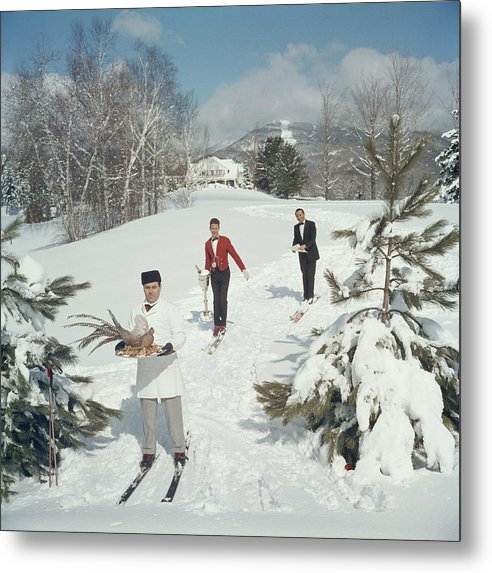 Skiing Metal Print featuring the photograph Skiing Waiters by Slim Aarons