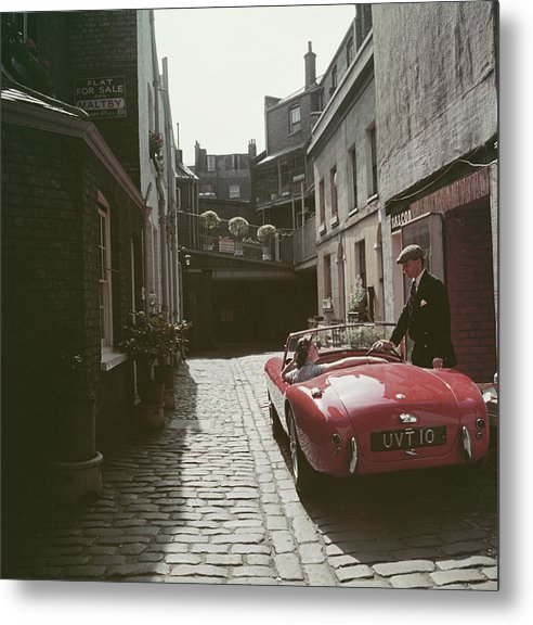 People Metal Print featuring the photograph Sports Car Couple by Slim Aarons