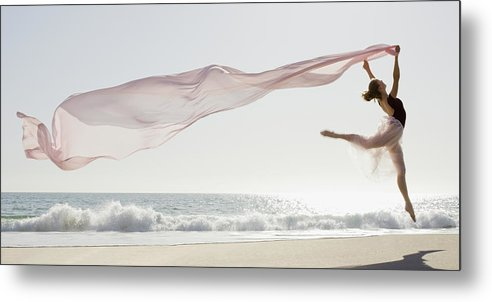 Ballet Dancer Metal Print featuring the photograph Dancer Leaping On Beach by Tetra Images - Pt Images