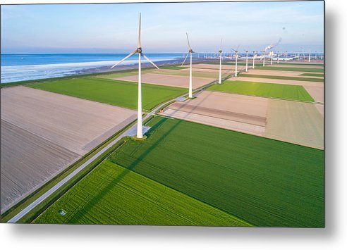 Wind Metal Print featuring the photograph Wind turbines lined up along coast towards industrial area by Daniel Bosma