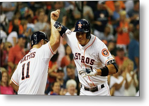 Evan Gattis Metal Print featuring the photograph Evan Gattis and Carlos Correa by Scott Halleran