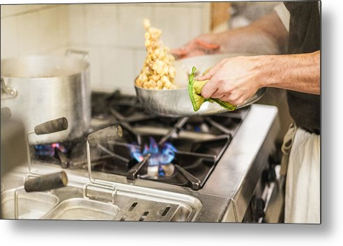 Working Metal Print featuring the photograph Midsection Of Chef Keeping Utensil On Stove In Kitchen by Niccol Pontigia / EyeEm