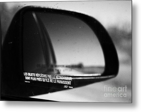 Objects Metal Print featuring the photograph objects in mirror are closer than they appear in french on car side window on highway Canada by Joe Fox