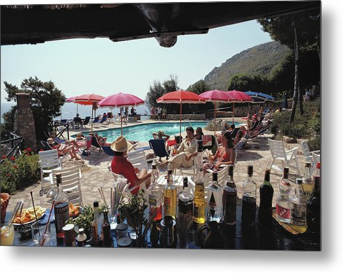 1980-1989 Metal Print featuring the photograph Poolside Bar by Slim Aarons