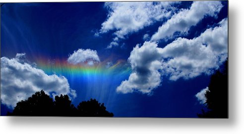 Heavens Rainbow Metal Print featuring the photograph Heavens Rainbow by Linda Sannuti