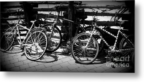 Bike Metal Print featuring the photograph Black And White Leaning Bikes by Emily Kelley